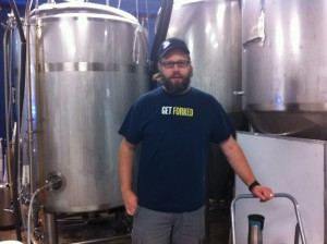 Dave Reed of Forked River Brewing, standing by some barrels