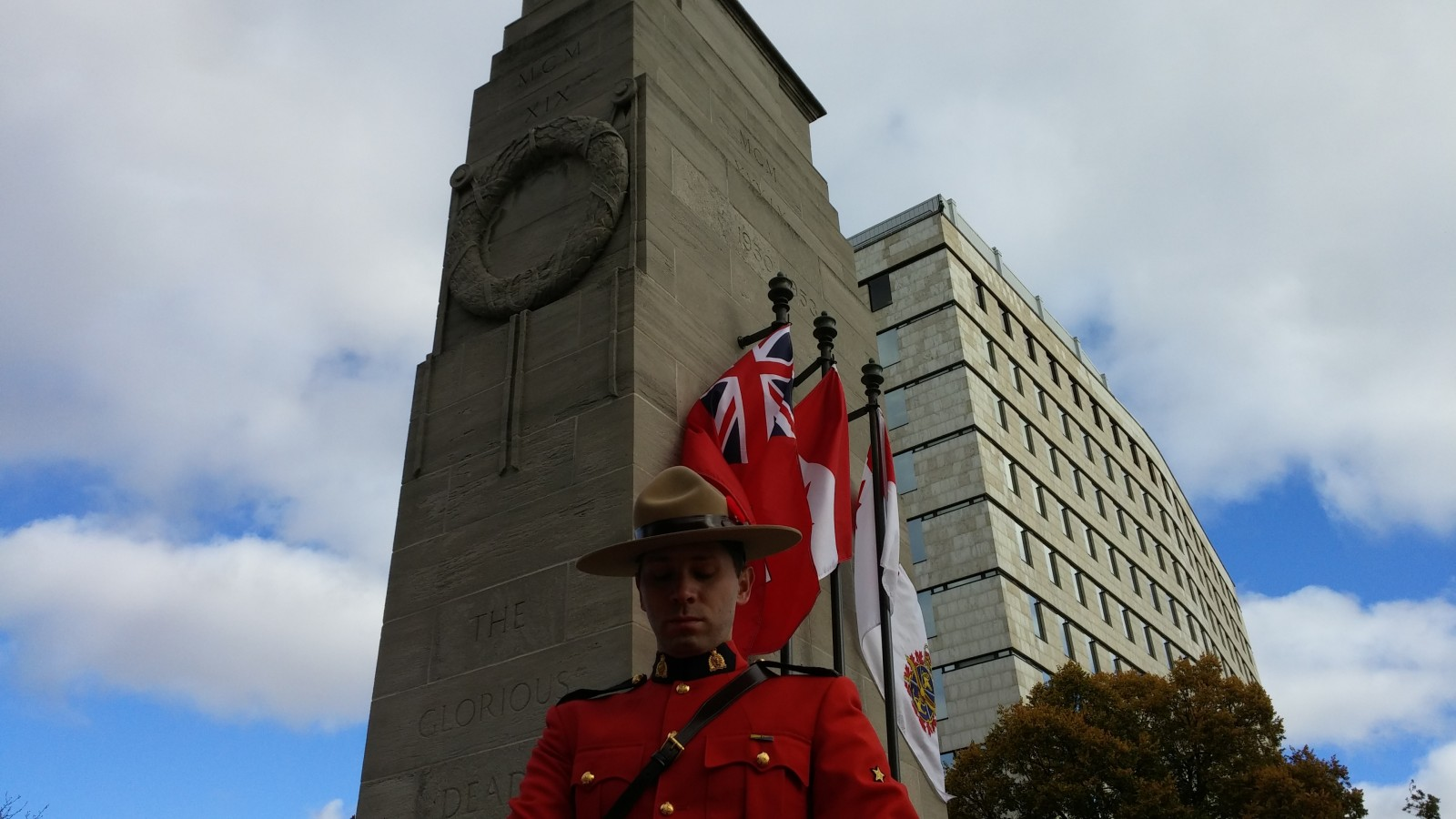 An RCMP officer stands in reverence at the Victoria Park Cenotaph Remembrance Day ceremonies in London, Ontario.